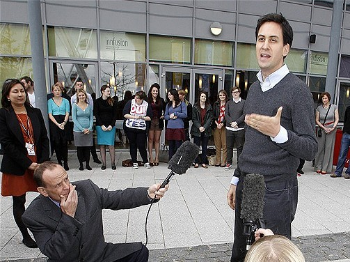 Ed Miliband talks to the public outside the Labour Party Conference